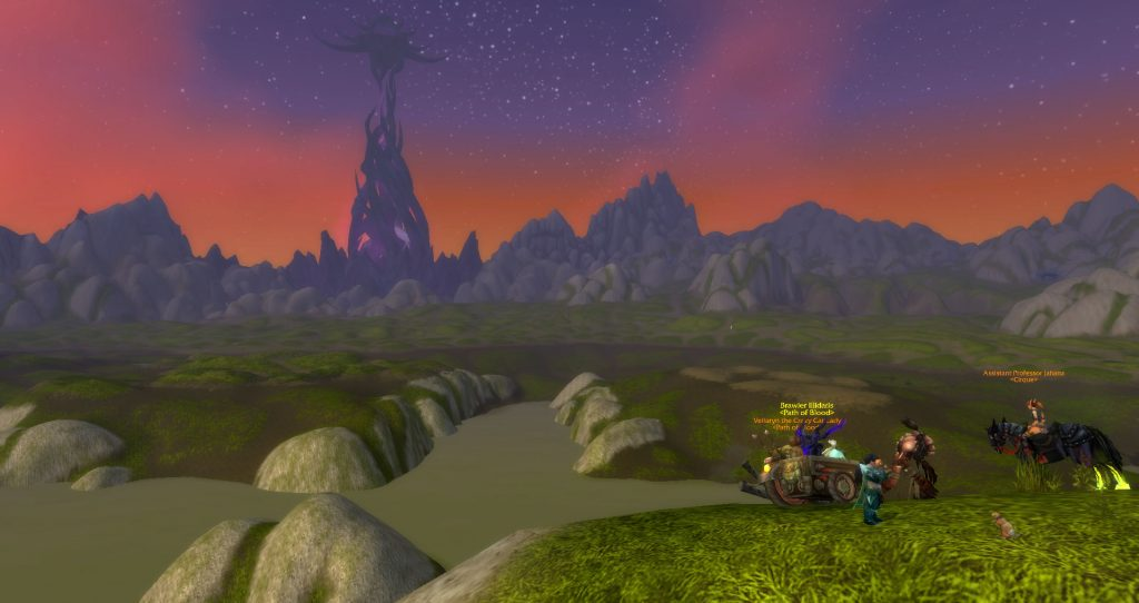 Da Doctas Tour pauses on the shore of the drained Loch Modan. Twilight Citadel can be seen in the distance.