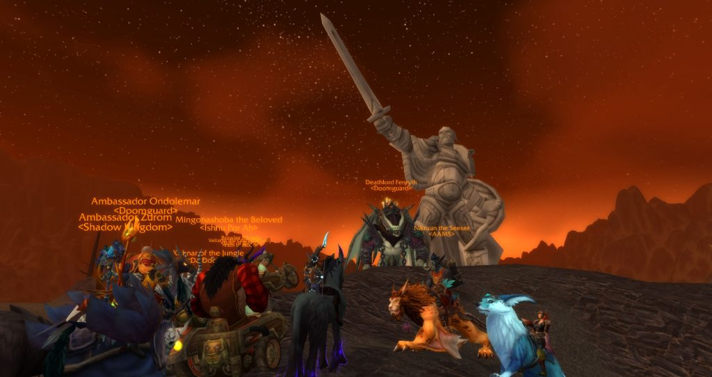 Da Doctas Tour pose at the base of the statue of King Anduin Lothar in the Burning Steppes.