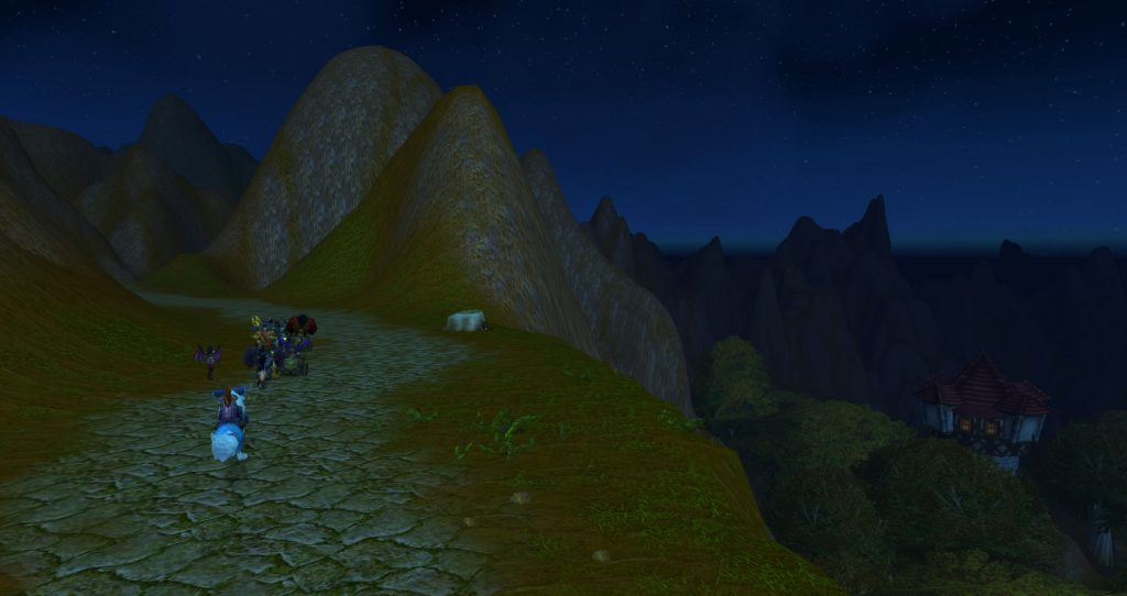 A human mage tower can just be seen in the valley to the right of the secret pass through the Redridge Mountains